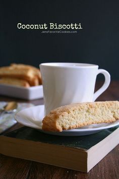 Coconut Biscotti - don't re-cook them and dip them halfway in chocolate - I think we may have something there :-)