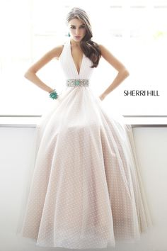 Sherri HIll #11250 - Boho meets Southwest in our Point d'esprit open-back halter ball gown. The impressive V neckline makes a deep plunge toward the silver conch jewelry and turquoise stone embroidered waistband.