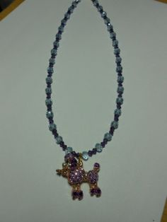 Purple Poodle necklace by Purrwoof on Etsy, $12.00