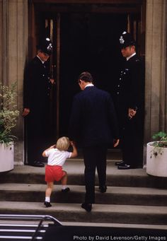 Prince William and Prince Charles climb the steps of St. Mary's hospital to welcome newborn brother Prince Harry.