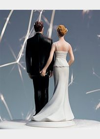 """Life is all about the little moments. Particularly those that no one knows about but you. This elegant couple takes romance - and fireworks - to a new level. Poised and elegant from the front, the back reveals a hidden little pinch - and a few extra """"sparks"""".  Features and Facts:  Hand painted porcelain.  Cake topper measures 5.5 inches with a base length of 2.75 inches.  Cake topper weighs 5.6 ounces."""