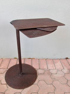 """when you have little space but need a table with character, the expanding end table with it's iron form + rust-like patina expands from 10"""" wide to 24"""" in no time. mixing a modern sense of form + function with an age-inspired finish, it's sure to serve in almost any style of home.  we recommend the use of coasters under hot + cold items as this table does not have a sealed finish  red's online exclusives are available as special orders + are not currently available at our brick + mortar…"""
