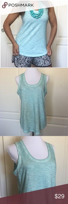 """New! Express Turquoise Burnout Muscle Tee Tank S New with tag! Express burnout muscle tee / tank top.  Size small. The color is a gorgeous light turquoise -- right between green and blue (my camera makes it look slightly more blue for some reason.)  Round neckline. Sleeveless. 100% cotton. Vintage-style dyeing for a burnout effect. Approx 19"""" across the underarms, unstretched. Approx 26"""" long. The material has some stretch. Smoke-free home. No trades. Offers welcome!💕 Express Tops Muscle…"""