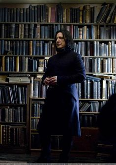 Professor Severus Snape in his home library. You gotta love a man who reads! Also reminds me of how much Snape valued logic. Made me miss the potions challenge Hermione had to solve for Harry to get the sorcerer's stone. Hermione Granger, Severus Hermione, Professor Severus Snape, Alan Rickman Severus Snape, Severus Rogue, Snape Harry, Draco, Albus Dumbledore, Harry Potter Fandom