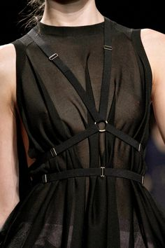 Harness style strapping against a simple sheer black dress - fashion details // Nina Ricci