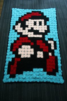 Crocheted Super Mario Afghan, no pattern but should be easy enough to figure out by looking at pic.