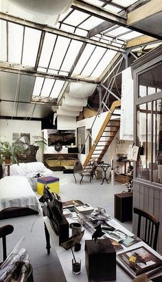 details I like: white walls, white floors • cluttered in a way that I don't mind • photo uncredited