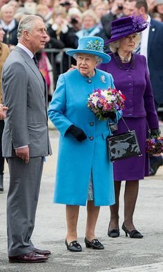 Queen Elizabeth II with Prince Charles, Prince of Wales and Camilla, Duchess of Cornwall attend the unveiling of a statue of Queen Elizabeth The Queen Mother during a visit to Poundbury on October 27, 2016 in Poundbury, Dorset.