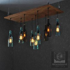 This is a 10 bottle chandelier made from any 10 bottles of your choice. It can be made with liquor bottles or wine bottles. The birchwood ply canopy is 18 x 36, but can be made in virtually any dimension. There is a metal firewall installed on the back side. The fixture floats down 1