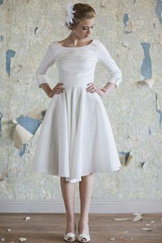 Tea length dress + sleeves = super cute. [Found via Wedding Party Blog.]
