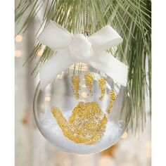 3-piece set. Ornament kit features glass ball ornament filled with snow, glue and gold giltter. Arrives gift boxed with instructions.