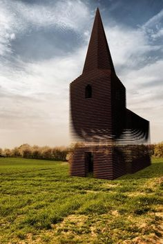 Gijs Van Vaerenbergh, Belgian architects, built a church that is see-through. They called it Reading Between The Lines. It has 100 stacked layers of steel. It was designed specifically so that the landscape around can always been visible through the church, making the church both visible and absent in the world around it.