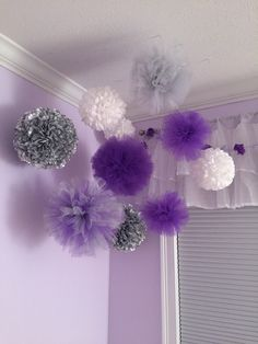 Baby nursery purple, lavender, gray pompom decor.