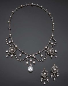 A SUITE OF ANTIQUE PEARL, DIAMOND, SILVER AND GOLD JEWELLERY, circa 1860