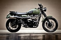 Triumph Scrambler w/ green line-x covering.  Awesome vintage look on a modern bike.