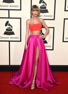 """After winning two Grammys in the pre-telecast -- one for Best Pop Vocal album for """"1989"""" and the second for Best Music Video for """"Bad Blood -- Taylor Swift won the Grammys red carpet too. Taylor rocked a custom two-piece creation by Versace featuring a coral-hued crop top and a magenta silk organza skirt. The ensemble featured a thigh-high slit, which revealed matching briefs and showed a lot of leg. She finished the look with a Lorraine Schwartz choker, gold sandals, her signature"""