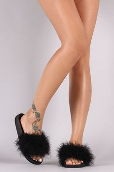"""This fluffy slide sandal features a wide band across vamp with soft faux feather detail and easy slip-on style. Material: Feather (man-made) Sole: PVC Measurement Heel Height: 0.75"""" (approx)"""
