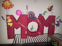 """Mops center piece idea for this years theme """"Beautiful Mess"""". Cut out letters in styrofoam wrapped cloth strips around them and wrapped in wire. Measures 8inches tall and 20 inches long."""