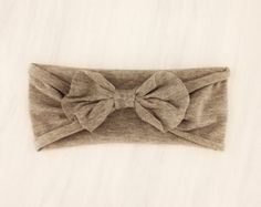 Gray Jersey Baby Girl Bow Headband - gray - baby girl headband - white - jersey knit - t-shirt - bow - tie knot - stretchy on Etsy, $6.99