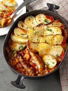 Turkey Sausage Hotpot:  2 tbsp olive oil  Pack of 6 British turkey sausages  1 onion, chopped  1 stick celery, chopped  2 carrots, chopped  300ml chicken stock  1 x 400g can chopped tomatoes  1 x 400g can baked beans  2 bay leaves  Salt and pepper  750g (about 4 medium sized) potatoes, thinly sliced  Knob of butter, melted