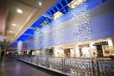 Meadowhall, Bespoke lighting, metres long lighting sculptures by Northern Lights. Diy Entertainment Center, Entertainment System, Visual Merchandising, Uk Retail, Lighting Suppliers, Branding, Affordable Furniture, Furniture Stores, Mounted Tv