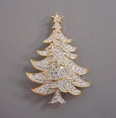 SWAROVSKI clear rhinestones Christmas tree brooch set in gold tone,