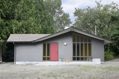 Renovated Seattle stable with Benjamin Moore Segovia Red-painted door.