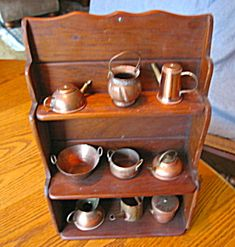 Vintage wood rack with vintage English copper miniature kitchen items for sale at More Than McCoy on TIAS