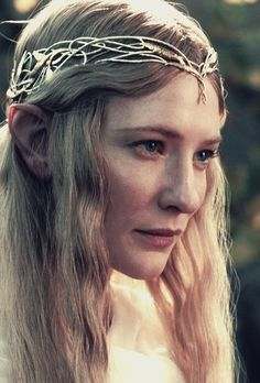 In Dwimordene, in Lórien Seldom have walked the feet of Men, Few mortal eyes have seen the light That lies there ever, long and bright. Galadriel! Galadriel! Clear is the water of your well; White is the star in your white hand; Unmarred, unstained is leaf and land In Dwimordene, in Lórien More fair than thoughts of Mortal Men.