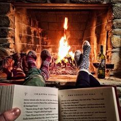 Sharing a book and a fireplace.