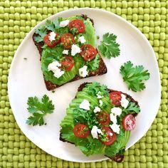 Avocado toast, feta, cherry tomatoes and coriander