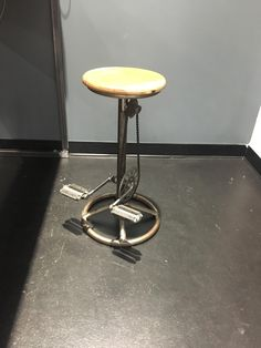 This chair made from repurposed bike pedals at a sports store