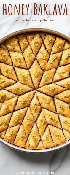 Honey Baklava Recipe - Saving Room for Dessert Honey Baklava Recipe with Walnuts and Pistachios - layers and layers of flaky phyllo slathered with melted butter, honey and loads of nuts - who can resist a slice of this delicious Honey Baklava Recipe? Walnut Recipes, Honey Recipes, Greek Recipes, Recipes With Walnuts, Recipe With Honey, Greek Dessert Recipes, Cooking With Honey, Sweets Recipes, Easy Recipes