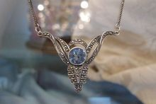 Art Nouveau blue Topaz and silver pendant dated at the turn of the 20th century