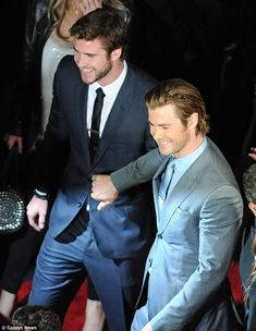 Chris Hemsworth jokingly pushes Liam aside during the LA premiere of Thor on Monday