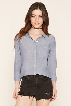 A woven button-down shirt made from chambray fabric and featuring a chest pocket, basic collar and long sleeves.