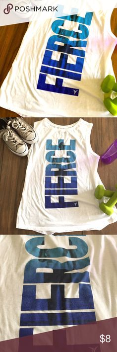Sleeveless Workout Shirt Muscle t-shirt. Lettering is in shades of blue (lightest at the top, darkest at the bottom). The shirt is white and is a bit sheer. You could do a just a sports bra or tank underneath depending on your comfort level. Old Navy Tops Muscle Tees