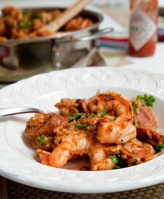 spicy rice and beans with shrimp and sausage -Yum! I used crushed tomatoes instead of diced because that's what I had. It worked out perfect. Sausage Recipes, Spicy Recipes, Lunch Recipes, Seafood Recipes, Gourmet Recipes, Mexican Food Recipes, Dinner Recipes, Cajun Rice, Spicy Rice