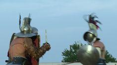 AQUILEIA - JUNE 22: Roman gladiator combat during the reenactment Tempora Aquileia on June 22, 2013 in Aquileia, Italy