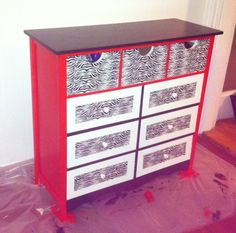 Took an old white dresser added some red & black paint with some zebra print duct tape.