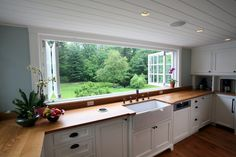 Huge kitchen windows that open all the way. LOVE this kitchen!