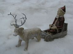 Santa with his reindeer (glazed clay)