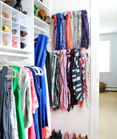 Turn Towel Bars into Scarf Storage | With these strategies up your sleeve, your bedroom closet will feel surprisingly spacious.