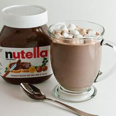 Nutella Hot Chocolate: 1 cup milk. 2 spoons nutella. Saucepan. Heat medium. Blend. Whisk frothy. OMG. I'll be glad I pinned this when I'm snowed in this winter...ha!