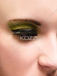 young woman's eye with yellow eye shadow. - Close-up of young woman's eye with yellow eye shadow, Model Megan Butt MUA: Irene Prowell