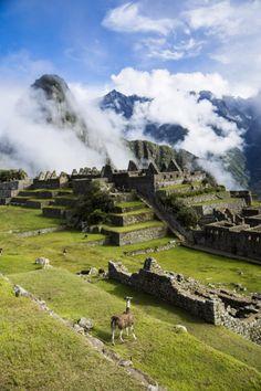 Machu Picchu up in the clouds, Peru by Tobias Mayr