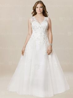 Plus size casual wedding dress features in soft Tulle with beaded lace appliques. Illusion back is finished with covered buttons over zipper closure. This dress is fully lined.