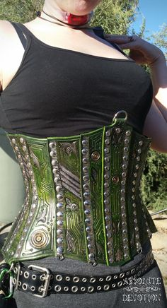 Leather Cyber Corset by Absolute Devotion. :) Fully hand carved and tooled leather armor styled hard leather corset with hand dyed details. For more photos including progress pictures please like Absolute Devotion on Facebook. :) https://www.facebook.com/pages/Absolute-Devotion/10099221406