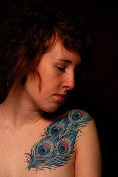 http://tattoomagz.com/peacocks-tattoos-on-shoulders/simple-womens-peacock-tattoo/