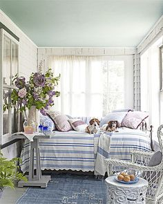 Cottage porch. MAINE. Coastal/Beach Cottage. Gorgeous Gardens, Gorgeous Porches. On this Maine cottage's porch, dogs Minnie (left) and Nash get cozy on an iron-and-brass daybed, sporting a vintage seersucker...